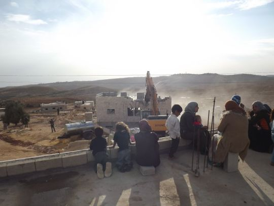 Palestinian women and children watch the demolition of a home in Ad Deirat, which is located in the south Hebron Hills (photo: Operation Dove)