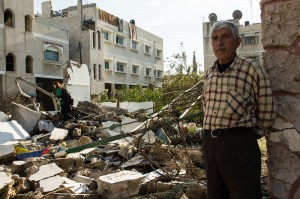 Ahmed Suleman Ateya standing next to his destroyed home in Gaza - Photo: Johnny Barber, November 29th, 2012