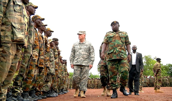 Army Major General David R. Hogg , center, commander of U.S. Army Africa, inspects Sierra Leone troops, May 20, 2012.