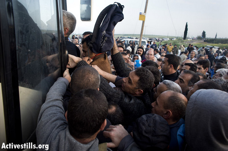 Palestinian workers with Israeli work permits try to board a 'Palestinian-only' bus. Credit: Oren Ziv/Activestills.org