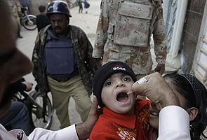 Polio vaccines in Pakistan. Note the guards.